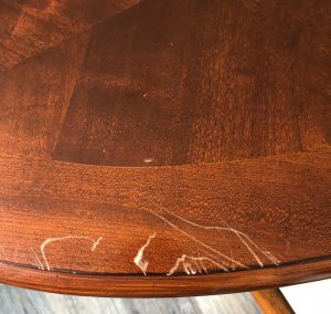 scratches on table fixed by french polisher