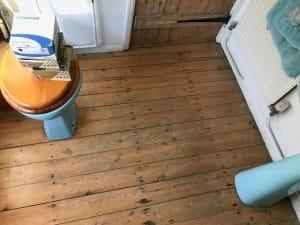 water damaged wooden floor